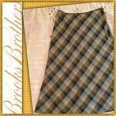 "Linen/Silk Plaid Skirt Excellent condition. Like new except for a few tiny pinholes just below the waistband - not noticeable (see 3rd pic). Bias cut so there's stretch in the hips. High quality smooth & lightweight fabric: 51% linen, 49% silk. Muted tones of green, blue & grey. Waist 27"", Length: 29"". Hidden side zipper & hook. High quality soft fabric & plaid matching at seams ala Brooks Bros. Brooks Brothers Skirts Midi"