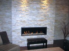Get inspired with this amazing photo of contemporary built in stack stone fireplaces. You can't be wrong with it.