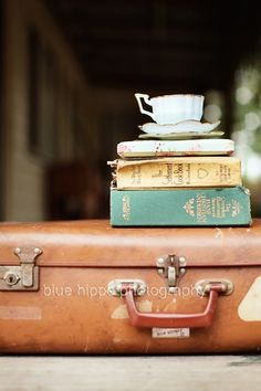 Cute idea for the suitcase stack - old books topped with vintage teacup / tea pot/ jug