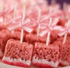 Rice krispy treats dipped in white chocolate and sprinkles, all on a stick. Cute idea for a baby shower or make them red and serve to your V...