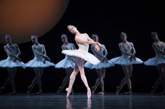 """Pacific Northwest Ballet principal dancer Lesley Rausch as Odette, with company dancers, in Kent Stowell's """"Swan Lake."""" (Photo by Angela Sterling) Ballet Pictures, Dance Pictures, Miss Claire, Pacific Northwest Ballet, Dance Magazine, Lake Photos, Misty Copeland, Best Dance, Swan Lake"""