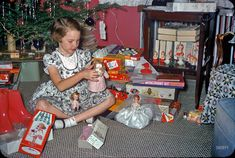 "Kodachrome 1957: ""Christmas 1957."" Having seen the boy toys at Kermy and Janet's house in Baltimore, we now move on to the girl gifts, which include Little Miss Revlon and Betsy McCall dolls as well as a Fun With Needlepoint Kit (""Make your own horse""). What else do we recognize here? 35mm Kodachrome slide."