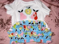 The cutest ruffle bottom onesies!  And a steal at $11.  Get these from LittleStitchinLu on etsy!