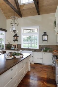 Love the look of a kitchen without upper cabinets.  Lots of storage in the island.