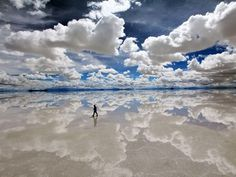 #relfections on #SaltFlats in #Bolivia where #Earth meets blues skies and #Cloud formations on the distant #horizon