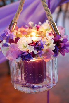 Nice purple flower arrangement with candle