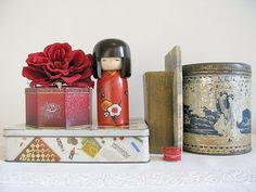 my first Kokeshi and my smallest tin ~ the tiny wee red one in the front... !
