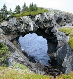 Berry Head Arch - Newfoundland, Canada This magnificent sea arch is located on the Spurwink Trail, along the East Coast Trail. East Coast Travel, East Coast Road Trip, Newfoundland Canada, Newfoundland And Labrador, Cool Landscapes, Beautiful Landscapes, Voyage Usa, Dubai, Cities