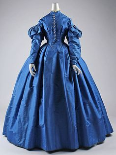 c. 1867 [1864-1867] dress, American. Silk. The Met, C.I.40.164.1a–c. [Only the slightly trained skirt and wide, flat box pleats give this a postwar look. The bodice and sleeves are fine for 1860-1865.]