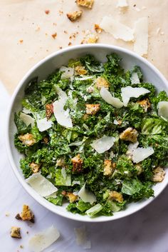 Kale and romaine caesar salad tossed in a garlicky greek yogurt caesar dressing without any egg! It's a delicious twist on a classic caesar salad.
