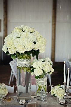 Hydrangeas in varying height vases wrapped in lace ribbon. Love.