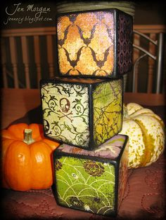 Halloween Blocks tops - scrapbook paper, mod podge  wooden blocks from the craft store!
