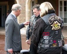 Prince Charles meeting a man from the Royal British Legion Riders Branch