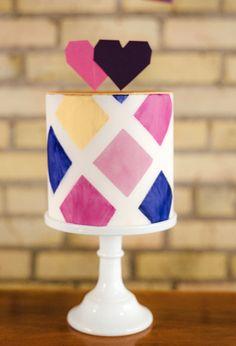 Modern geometric pattern wedding cake with heart cake topper