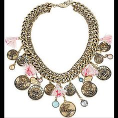 Betsey Johnson necklace Selling to buy Betsey pieces I need. This is from the pet shop collection. The necklace is gold tone . The necklace has several coins of portraits of dogs and cats with rhinestones. There are also colored tastes, and dangling stones. There are also puffy hearts. New Betsey Johnson Jewelry Necklaces
