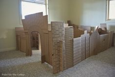 Indoor Cardboard City Play Space for littles while bigs do school work.