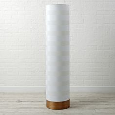 Shop Pillar Floor Lamp.  Pillar shaped floor lamp features a cotton shade and steel base with wood veneer.  The unique design allows it to look good whether it's turned on or off.