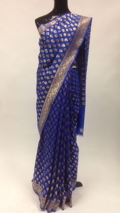 Beautiful blue and gold banarasi silk saree with attached blouse piece. The sarees are among the finest sarees in India and are known for their gold and silver brocade or zari, fine silk and opulent e