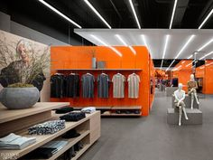 Joe Fresh brand's signature orange hue and soft grays enliven the store. Toronto designer Diego Burdi, creative director and founding partner of Burdifilek, planned the clothing brand store to reflect its evolving identity, ensuring its core values translated into the industrial space. #InteriorDesign #RetailSpaces #DesignInspiration Interactive Mirror, Grey Ceiling, Luxury Store, Wood Cladding, Downtown Toronto, Design Strategy, Retail Space, Wood Laminate, Joe Fresh