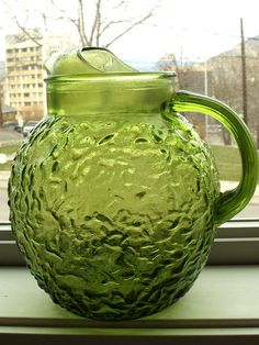 Beautiful Retro green glass pitcher, circa 1970's. Great for summer lemonade with friends, punch party entertainment, or just as a collectible.