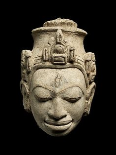 Head of a Male Divinity. Date: 8th century. Culture: Central Thailand. Medium: Stucco.