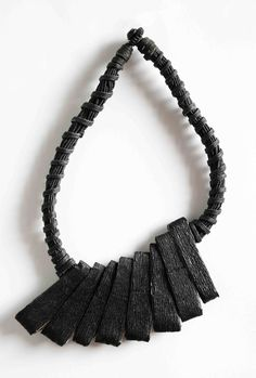 This jewelry and inspired by the movement of the herringbone motif of the vase of the third millennium BC tatrapode found in Domus de Janas of santu perdu of Alghero.    Dimensions: H.29 cm; L.18,5    UNIQUE.   JEWEL MADE OF PAPER.   MADE IN ITALY.   HANDMADE.