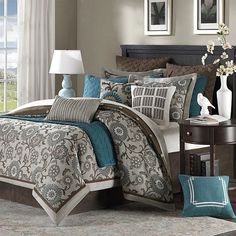 Love this sort of dark teal color. I am painting my bedroom gray and I think I want to accent with this teal color ... I would love to find a comforter like this, but less expensive....