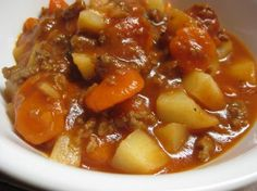 Crock pot beef stew with ground beef - sprinkle in a lot of bread crumbs