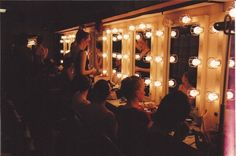 DRESSING ROOM LIGHTS. MAYBE THE MIRROR THE COUNTESS LOOKS INTO AT THE END?