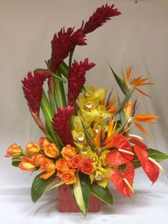 Anniversary party bouquet with tropical fall colors Tropical Flower Arrangements, Modern Floral Arrangements, Flower Arrangement Designs, Artificial Floral Arrangements, Altar Flowers, Church Flowers, Funeral Flowers, Exotic Flowers, Tropical Flowers