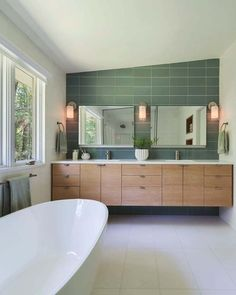The understated green tones and the clean lines in this beautiful bathroom are key elements of the Mid-Century Modern Style. Mid Century Modern Bathroom, Modern Master Bathroom, Modern Bathroom Design, Mid Century Modern Design, Bathroom Interior Design, Modern House Design, Mid Century Bathroom Vanity, Mid-century Interior, Master Bathrooms