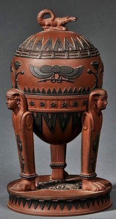 Wedgwood Rosso Antico Egyptian Vase and Cover ~ Early 19th century, chocolate-brown ground w/ crocodile finial, applied black basalt hieroglyphs in relief to a bowl supported by three sphinx-topped legs set on a raised circular base.: