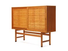 high cabinet by Hans J. Wegner | From a unique collection of antique and modern cabinets at http://www.1stdibs.com/furniture/storage-case-pieces/cabinets/
