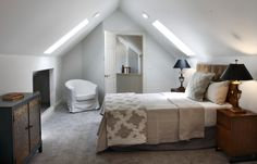 Guest room with slanted ceilings and skylights