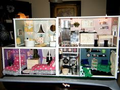 I made this dollhouse for my granddaughter, using boxes and scrapbook paper for the rooms. I made all the furniture and everything in it.