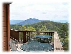 Have coffee or lunch on the deck with gorgeous mountain views - Inspiration Point Cabin just outside of Pigeon Forge TN