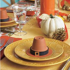 Thanksgiving place setting with Pilgrim hats made from mini terracotta pots - clever!!! Put a name on it too.