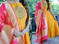 Rawsilk anarkali with heavily embroidered yoke teamed up with hot pink banaras dupatta customised for a client . <br> Can be made in different color combinations as per your prefrence. <br> Kindly write to teamyellow@yellowkurti.com for Orders !