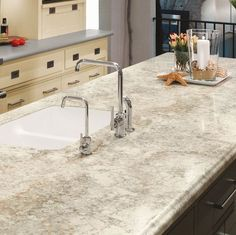 Formica 180fx countertops in Crema Mascrello. A little more expensive than standard laminate countertops but far cheaper than granite. Has a 5 wide pattern, to duplicate the look of real stone!