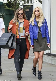 A successful trip! Nicola looked happy and relaxed as she strolled down the street with her female friend