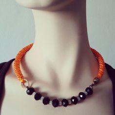 Collar Luvjan de seda.. elegante, sencillo y la combinacion del naranja con el negro lo hace especial www.facebook.com/bycosmicgirl
