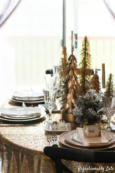 Glam Holiday Tablescape- Love the flocked greens and golden trees
