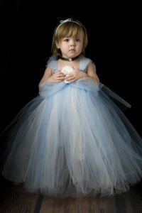 This adorable dress is sure to delight your little princess!  Outfit includes adorable cortillion blue and white tutu dress with a white removable flower, a black ribbon choker with rhinestone and a soft blue satin ruffle elastic headband!  For the flower center, you may choose between a bottlecap with a photo of Cinderella (pictured) or a large rhinestone.