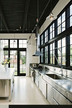 Industrial Kitchen Lighting- As one of the most crucial areas in a house, the kitchen always needs a lot of attention from the homeowner. Industrial Kitchen Design, Industrial Loft, Stainless Steel Kitchen Design, Vintage Industrial, Industrial Farmhouse, Industrial Lighting, Modern Farmhouse, Industrial Kitchens, Stainless Steel Cabinets