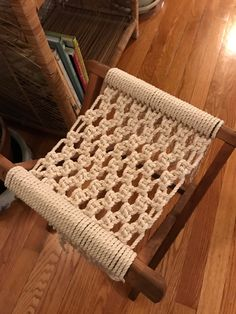 Macrame fringed seat on a vintage wooden camping stool, made from 3 ply cotton rope. Measures 15.5 wide, 14 deep, and 15 tall. Will comfortably sit a child or adult up to 130 lbs. Folds up while not in use.