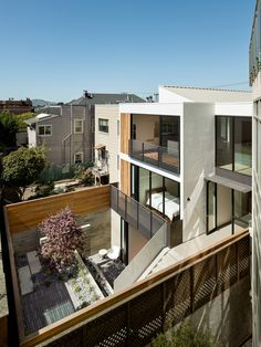 Gallery of Laguna Street Residence / Michael Hennessey Architecture - 6 Check out how the deck is enveloped in the interior spaces to give coverage and protection-also the metal eyebrow creates overhang at lower level.