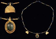 """ROMAN GOLD AND GLASS NECKLACE. II-III century C.E. Consists of hollow, gold ribbed tubes spaced by groups of three blue glass beads; two semicircular gold pendants with incised  lines and a suspension loop with single granulation at the top; central pendant with incised lines and granulation on the back, beaded wire perimeter and green glass cabochon set in collar with incised  lines and pinched edge.  Suspension loop decorated by granulations on top.  L. 15.2"""" (38.6 cm)."""