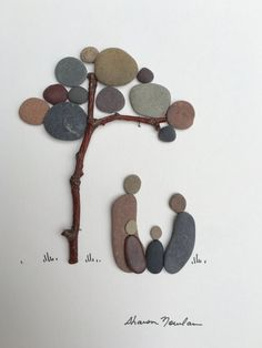Sharon nowlan pebble art family of four 8 by 15 by PebbleArt