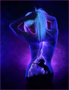 John Poppleton uses UV body paint to create scenes of nature and space, and then brings them to life under a black light.