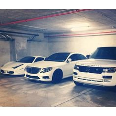 His, MIne, and Ours.....I'll take it, lol...White Ferrari, Mercedes-Benz, & Range Rover car